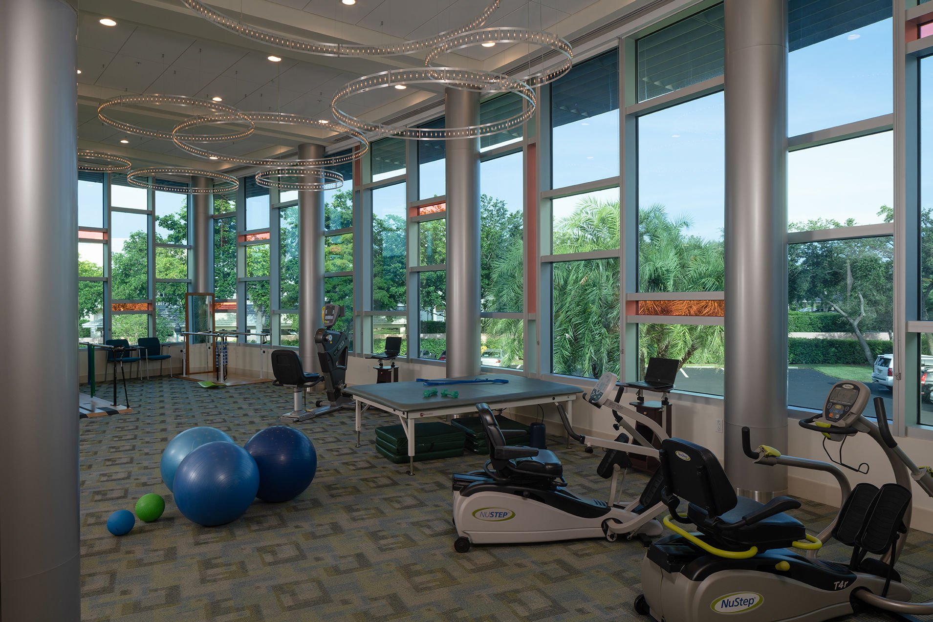 The Glenview at Pelican Bay Rehab Wellness Exercise Room Healthcare Florida Senior Living THW Design
