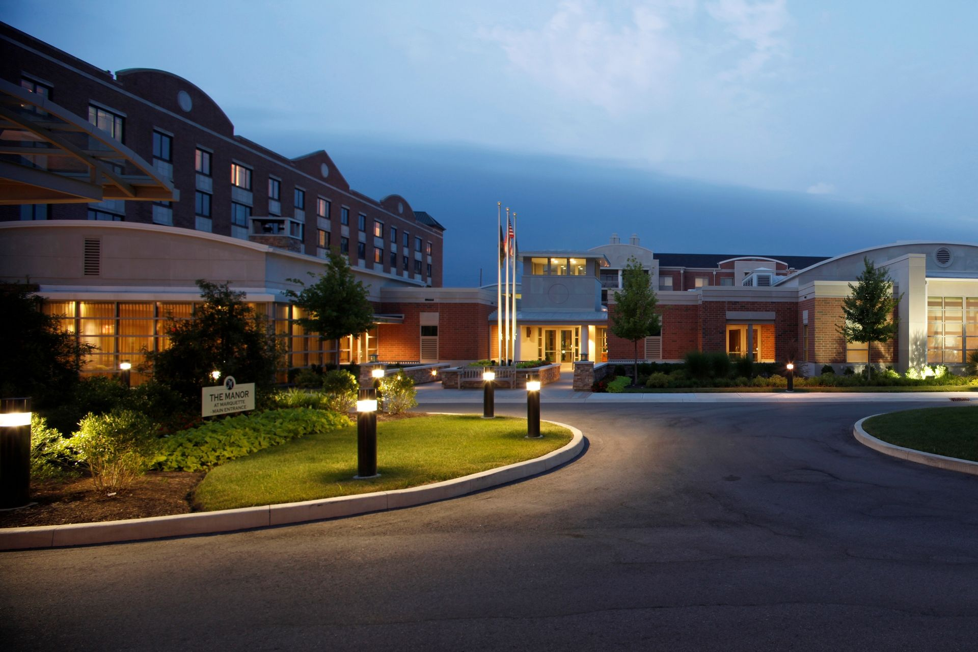 THW | Marquette | Entry Drive at Night Time | Senior Living Design